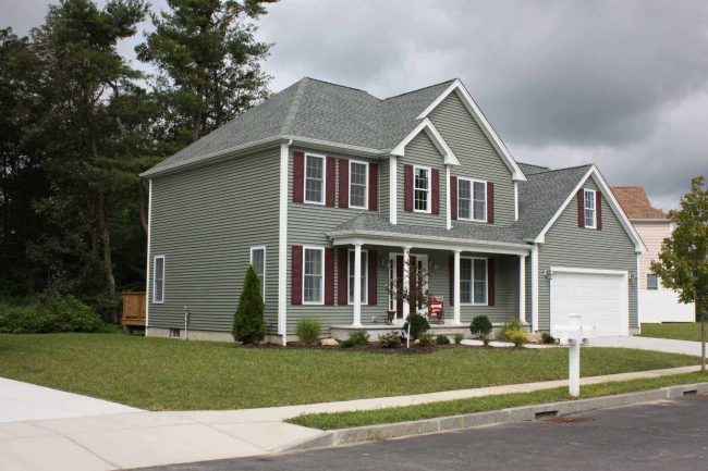 siding company in mansfield gray vinyl siding on two story home