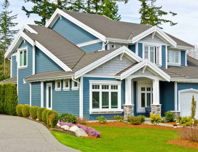 siding company in mansfield home with blue siding