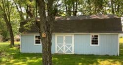 roof repair Mansfield Ohio blue barn with shingle roof