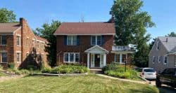 roofers mansfield ohio two story brick home with shingle roof