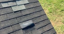 roofers near me Mansfield roof with wind damaged shingles