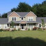 roofing company lexington ohio tan house with asphalt roof