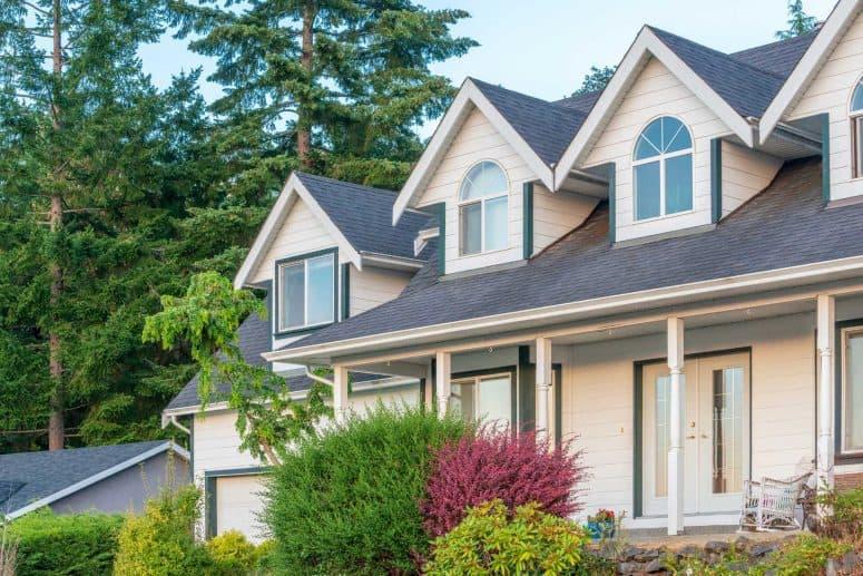 Galena Ohio roofing company home with tan siding and asphalt shingle roof