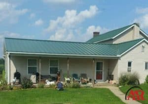 metal roofing mount vernon ohio home with green metal roof and gray siding