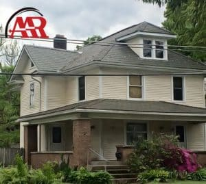 slate roofing Mount Vernon Ohio home with gray slate roof and cream siding