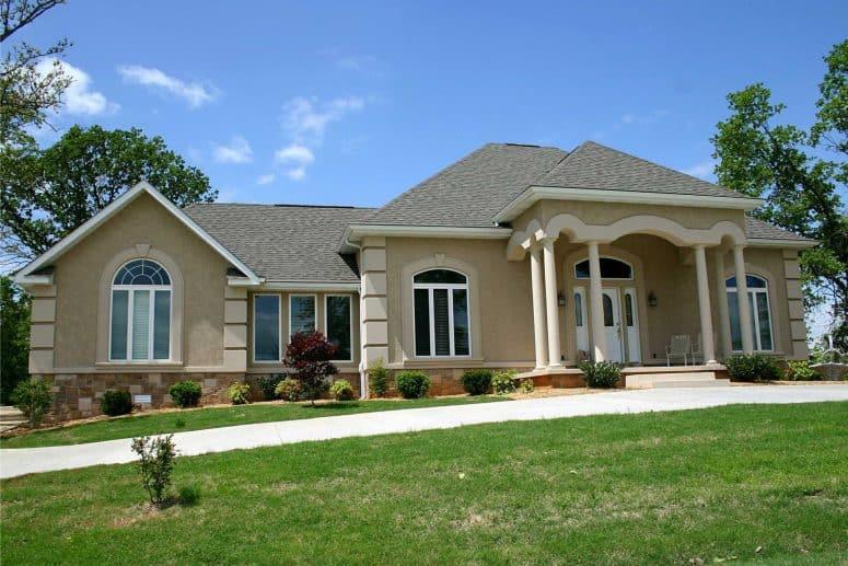 roofing company newark ohio home with brown stucco and asphalt shingle roof