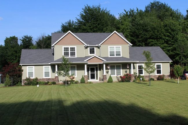why you should use vinyl siding home with tan and brown vinyl siding