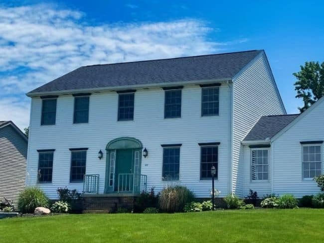 home with siding repair and roof repair
