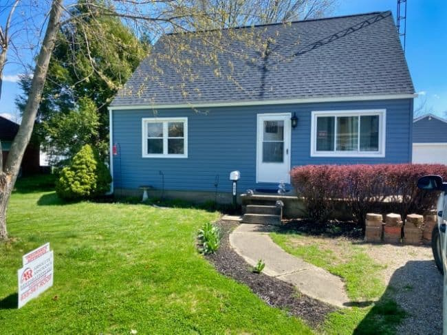 blue siding installation by siding contractors