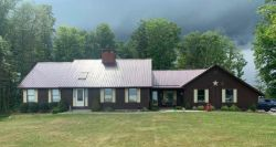 roofing companies Galion Ohio home with metal roofing