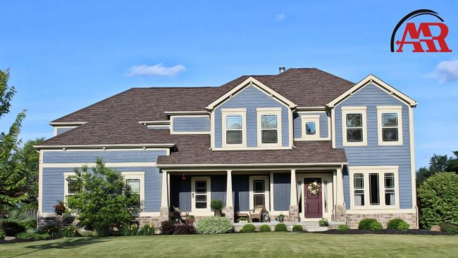 siding contractor dublin ohio home with blue siding and slate roofing