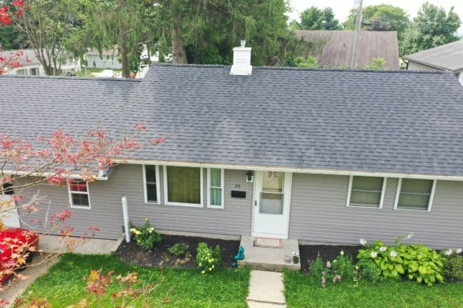 Mansfield roofing and vinyl siding company home with new shingle roof and gray vinyl siding
