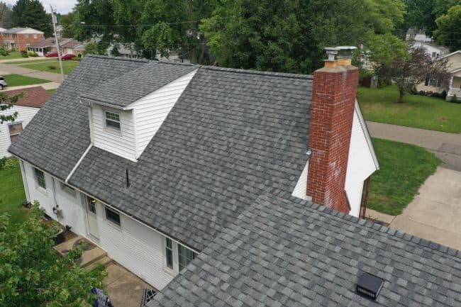 Mansfield roofers roof replacement and vinyl siding installation and chimney flashing on home