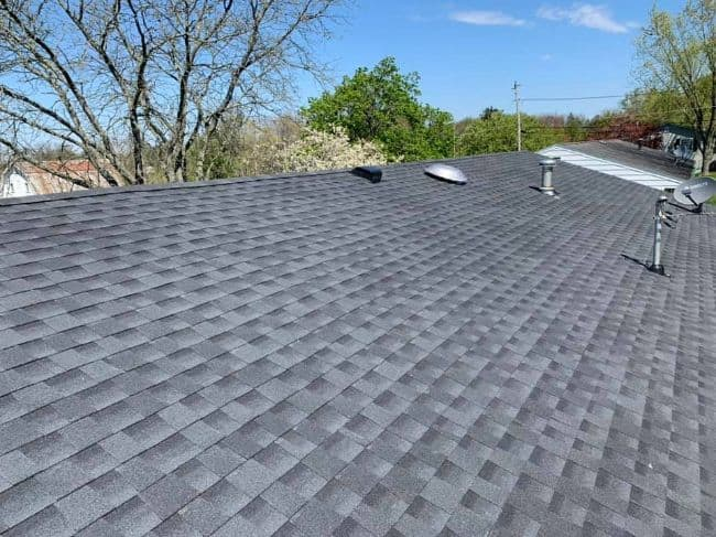 gray shingles on a new roof installation