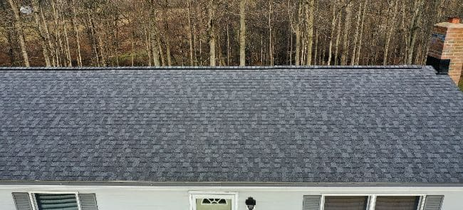 home with new blue roof installed by roofing contractors in Mansfield Ohio