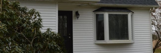 newly installed white siding by siding contractors in Mansfield Ohio