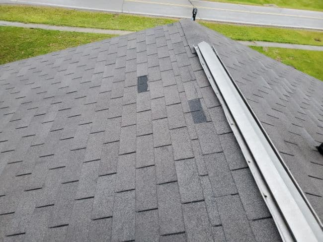 roof with wind damage and missing shingles storm damage roof repair