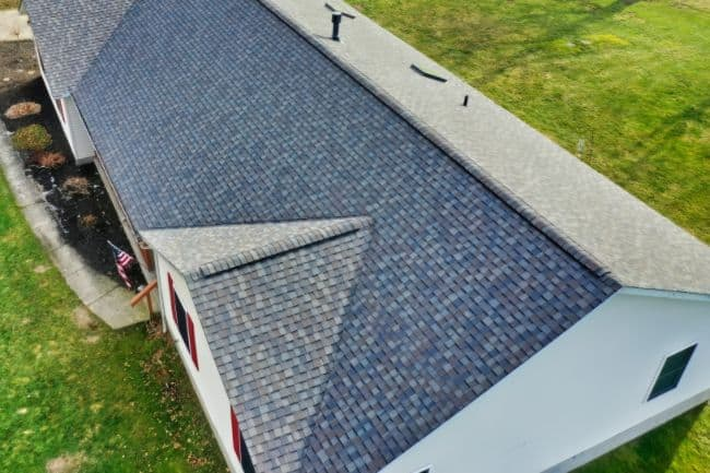 storm damage roofing replacement on home with skylights